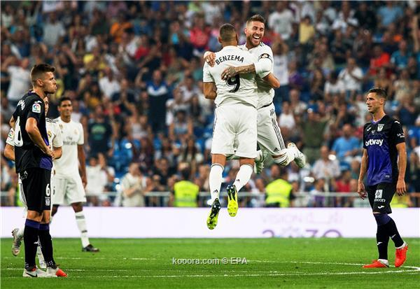 Real Madrid's Karim Benzema (C-L) celebrates with his teammate Sergio Ramos (C-R) after scoring a goal during the Spanish La Liga soccer match between Real Madrid and CD Leganes in Madrid, Spain, 01 September 2018.