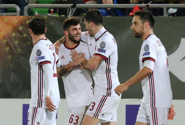 رومانيولي مع لاعبي ميلان