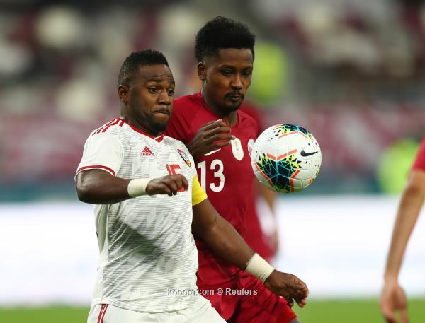Soccer Football - Gulf Cup - Group A - Qatar v United Arab Emirates - Khalifa International Stadium, Doha, Qatar - December 2, 2019   United Arab Emirates' Ismail Al Hammadi in action with Qatar's Musab Kheder