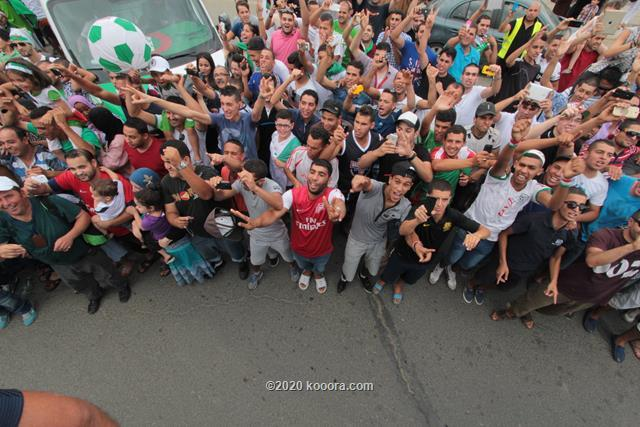 """بالفيديو والصور.. إستقبال الأبطال لمنتخب """"الخضر"""" في الجزائر Koo_18"""