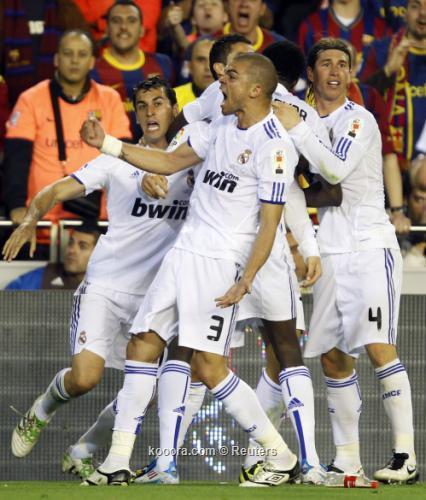 ** صور روعة من نهائي الكأس * ريال مدريد - برشلونة * مبرووووووووووك يا ملكي.. I.aspx?i=albums%2fmatches%2f637291%2f2011-04-202011-04-20t215519z_01_svp31_rtridsp_3_soccer-spain-cup_reuters