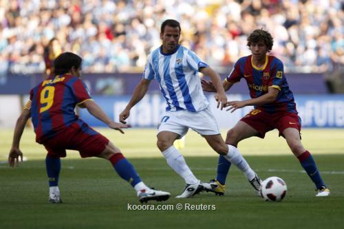 برشلونة البطل ينهي مشواره في الدوري بالفوز على ملقة  I.aspx?i=reuters%2f2011-05-21%2f%2f2011-05-212011-05-21t162258z_01_jn43_rtridsp_3_soccer-spain_reuters
