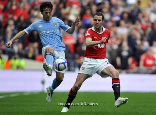 مانشيني يتفوق فيرجسون ويقود مانشستر 2011-04-162011-04-16t171335z_01_wem710_rtridsp_3_soccer-england-cup_reuters.jpg