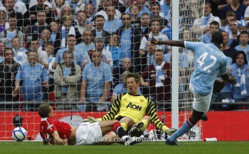 مانشيني يتفوق فيرجسون ويقود مانشستر 2011-04-162011-04-16t173810z_01_wem716_rtridsp_3_soccer-england-cup_reuters.jpg