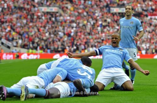 مانشيني يتفوق فيرجسون ويقود مانشستر 2011-04-162011-04-16t174712z_01_wem722_rtridsp_3_soccer-england-cup_reuters.jpg