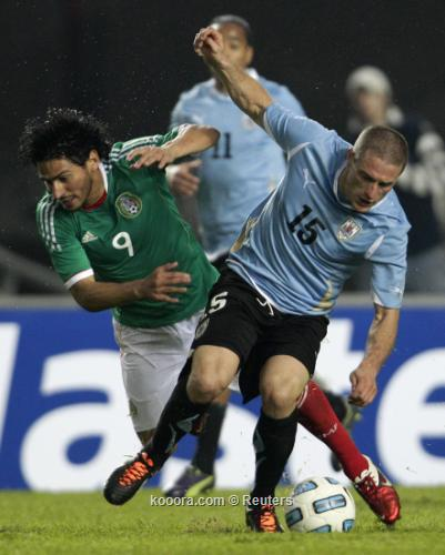 أوروجواي تفلت من كمين مهاجميها 2011-07-13t022046z_01_mdz546_rtridsp_3_soccer-copa_reuters.jpg